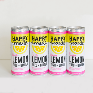 This image is 4 x 250ml cans of Happy Inside - lemon, yuzu and ginger gut health drink.