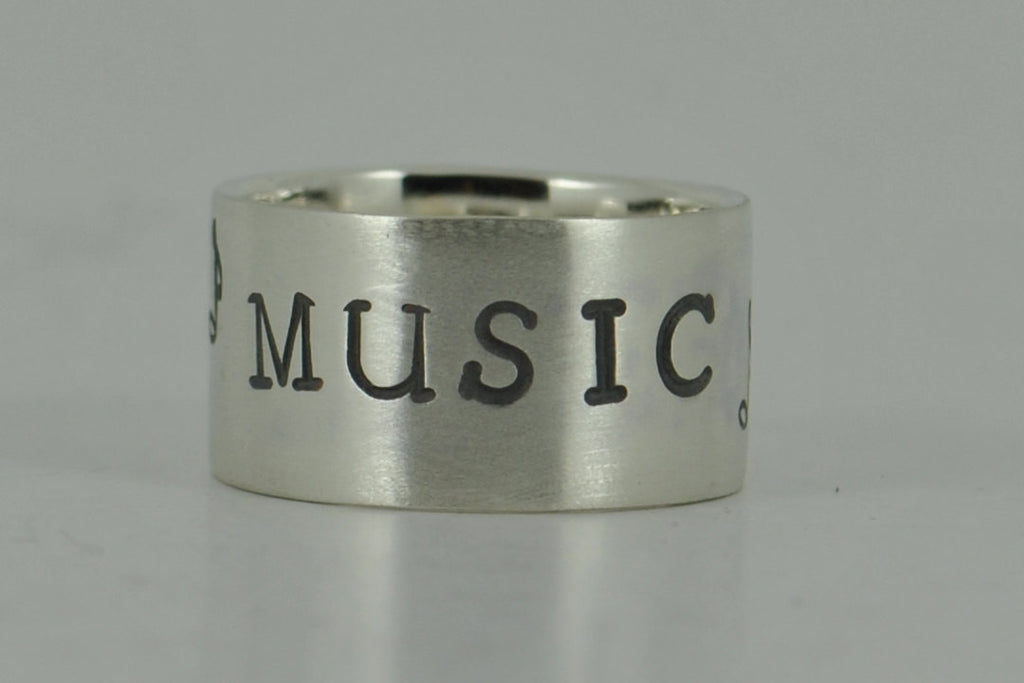 Sterling silver wide band MUSIC stamped ring