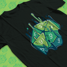 Load image into Gallery viewer, Low angle of tee shirt with green 20 sided die melting upwards with magic.