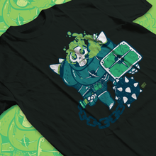 Load image into Gallery viewer, Low angle shot of teeshirt with a skeleton in bulky armor holding a smile ball on a chain along with a shield. Smoke billows from his eyes and skull as it smokes.