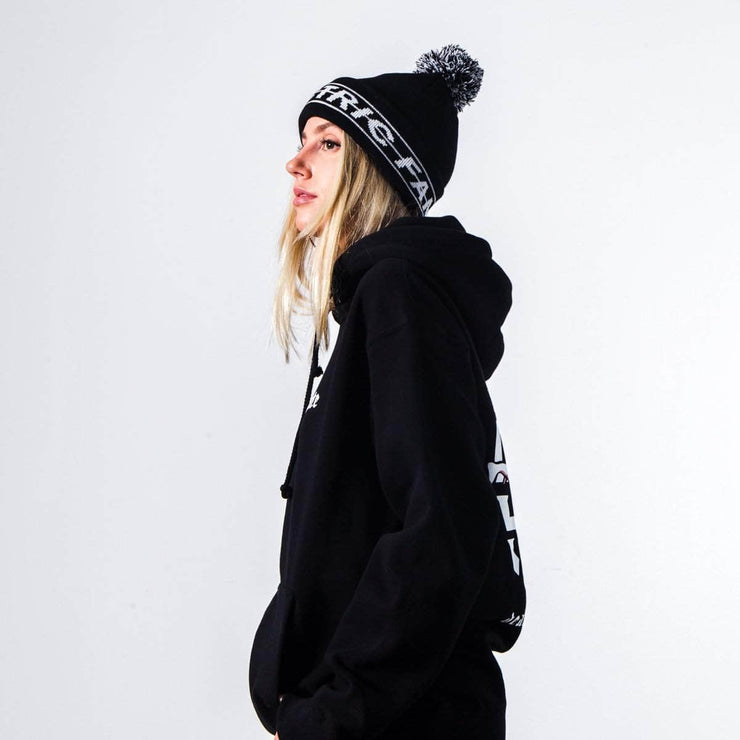 Strike Through Pom Beanie