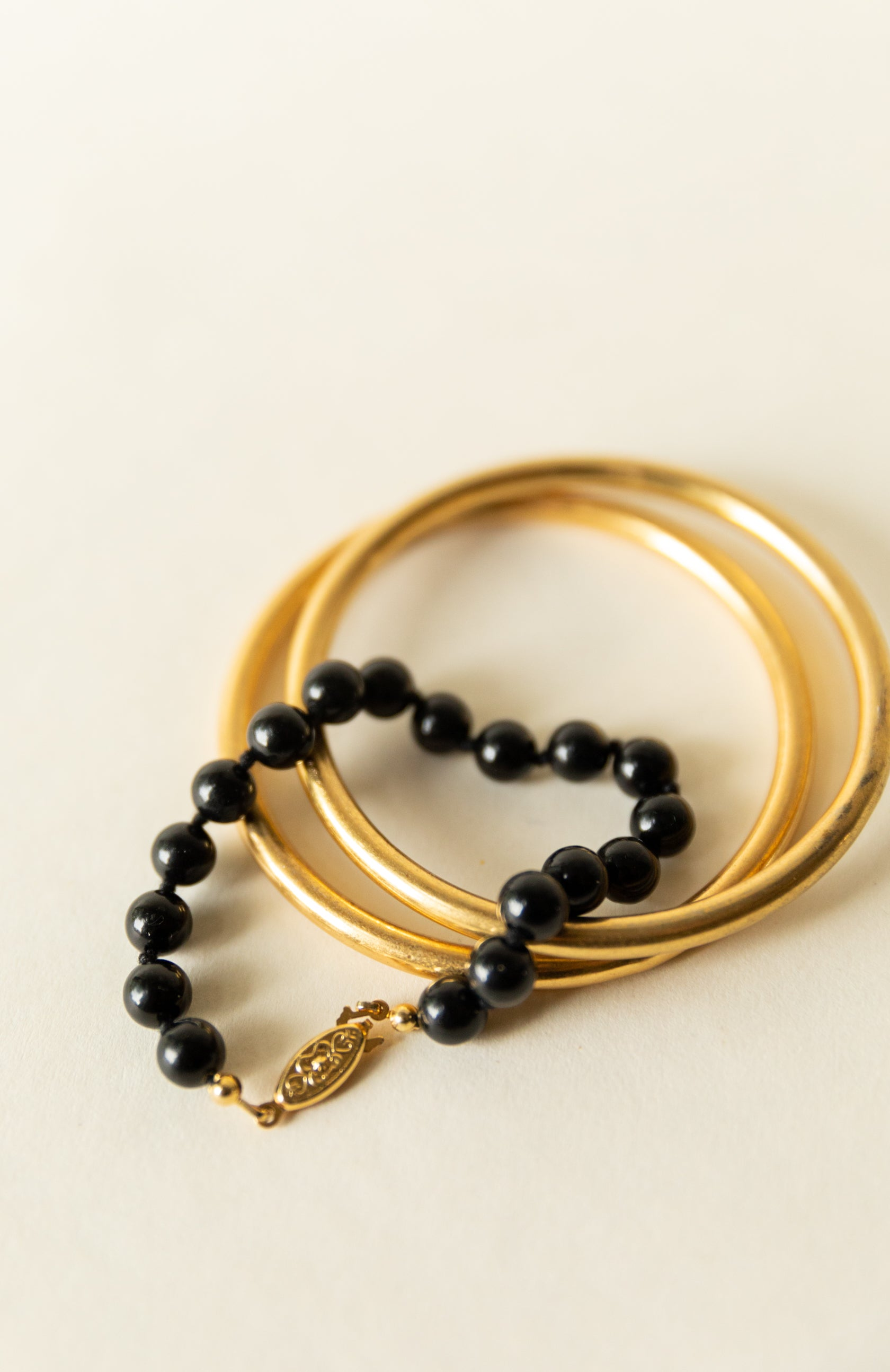 Black Beaded Bracelet with Gold Style Latch