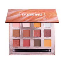 "Load image into Gallery viewer, Image of the ""burning"" eyeshadow palette opened with the 12 colors and a brush incorporated"