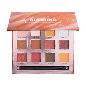 "Image of the ""burning"" eyeshadow palette opened with the 12 colors and a brush incorporated"