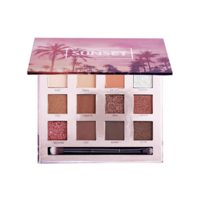 Image of the sunset eyeshadow palette opened with the 12 colors and a brush incorporated