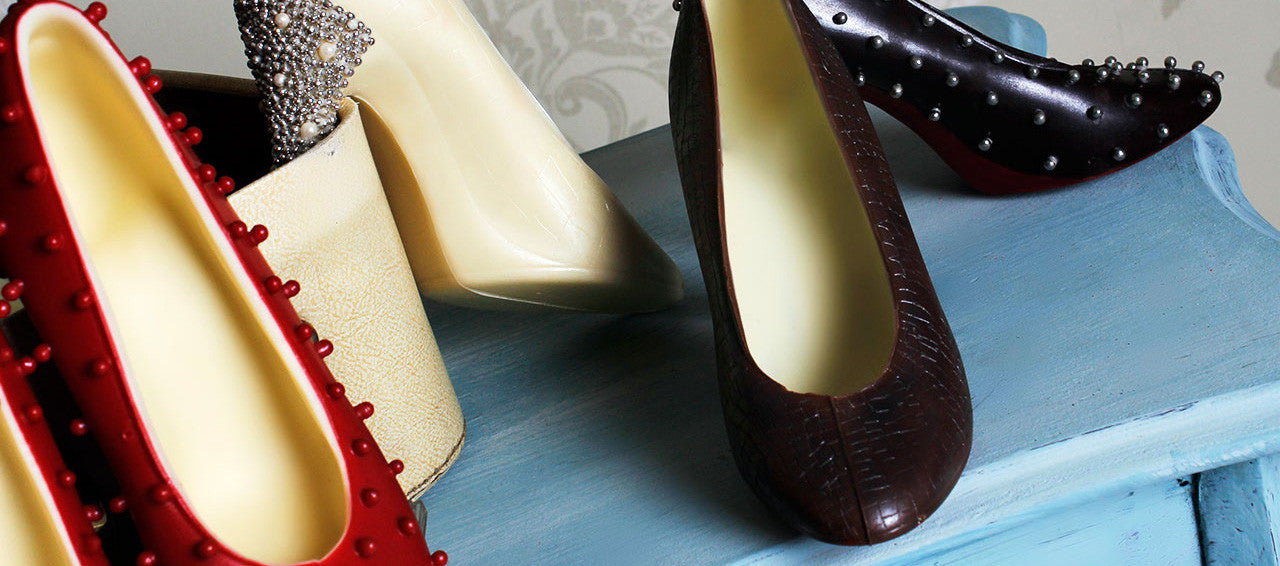 chocolate favours, shoes and baby shoes