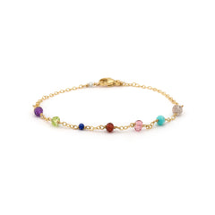 Delicate gold bracelet with multi colored stones