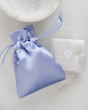 Blue satin pouch with glassine envelope