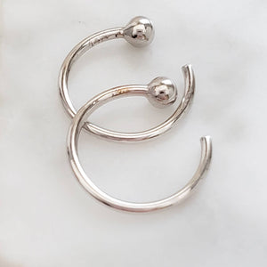 White gold open huggie hoops with 2mm ball beads on white background