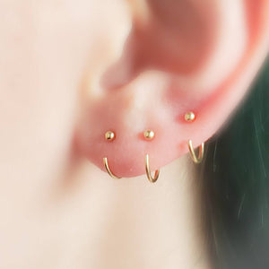 3 yellow gold open hoops with 2mm ball beads on ear