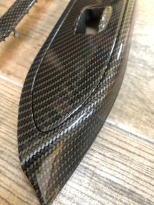 HFC-132 Hydroimpression car moldings in carbon fiber film with black and silver colors.