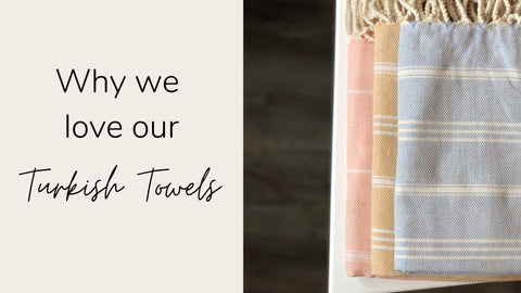 "Image of Stray & Wander Turkish Towels in blue, yellow and pink - text to the left reads ""why we love our turkish towels"""