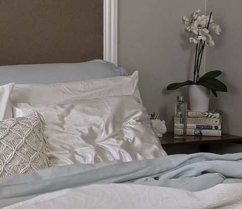 Bed with white silk pillowcase