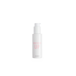 Small white bottle that reads Dressed Up in pink font - Dressed Up is Hairstory's natural heat protectant solution for all hair types