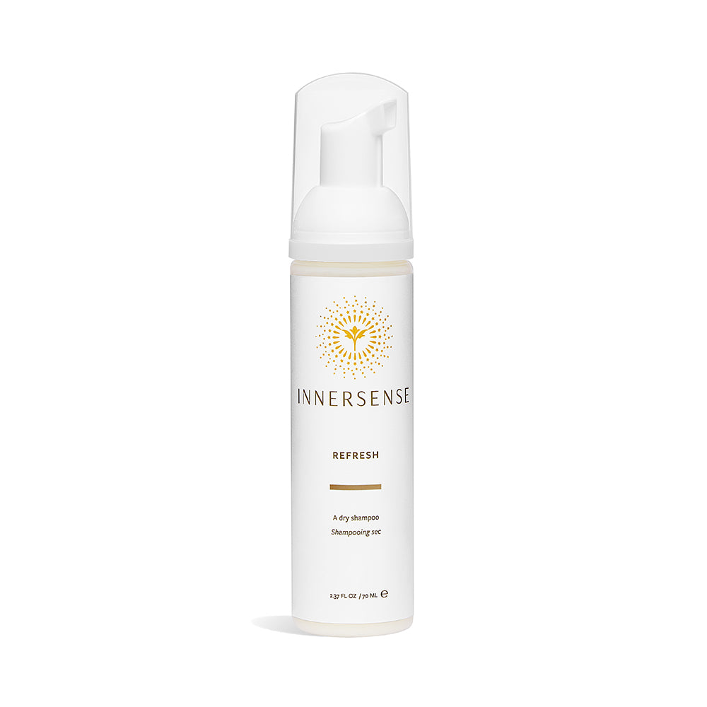 2.37oz White bottle that reads Innersense Refresh - organic dry shampoo for natural haircare