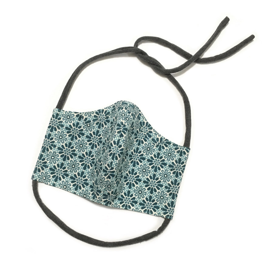 Persimmon Peak: teal tiles face mask, front