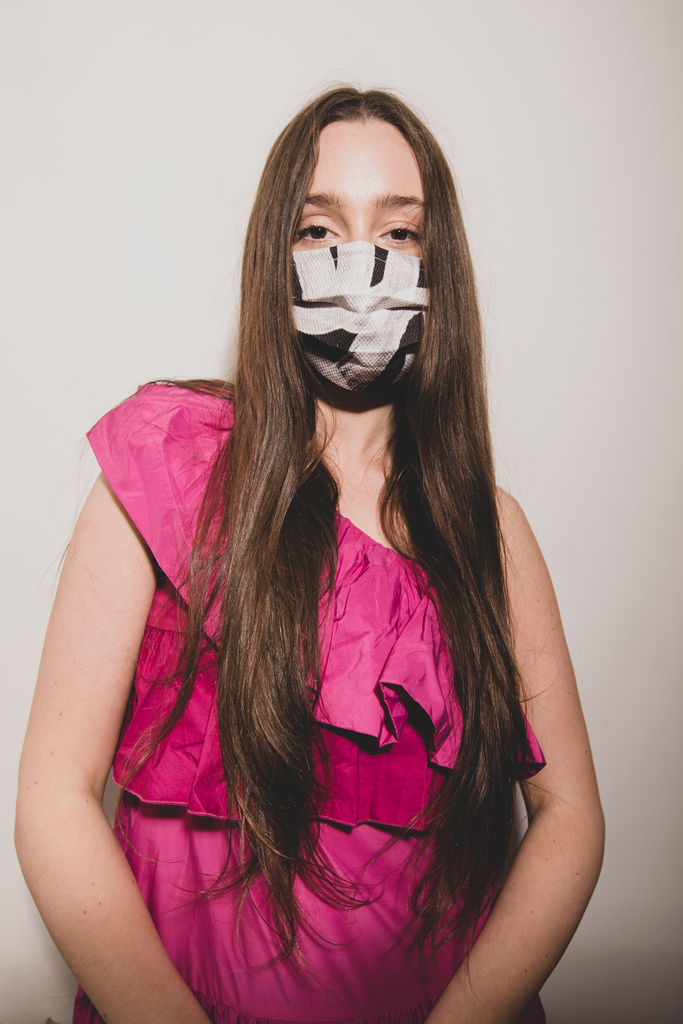 Model wearing a black and white Nim adjustable elastic face mask