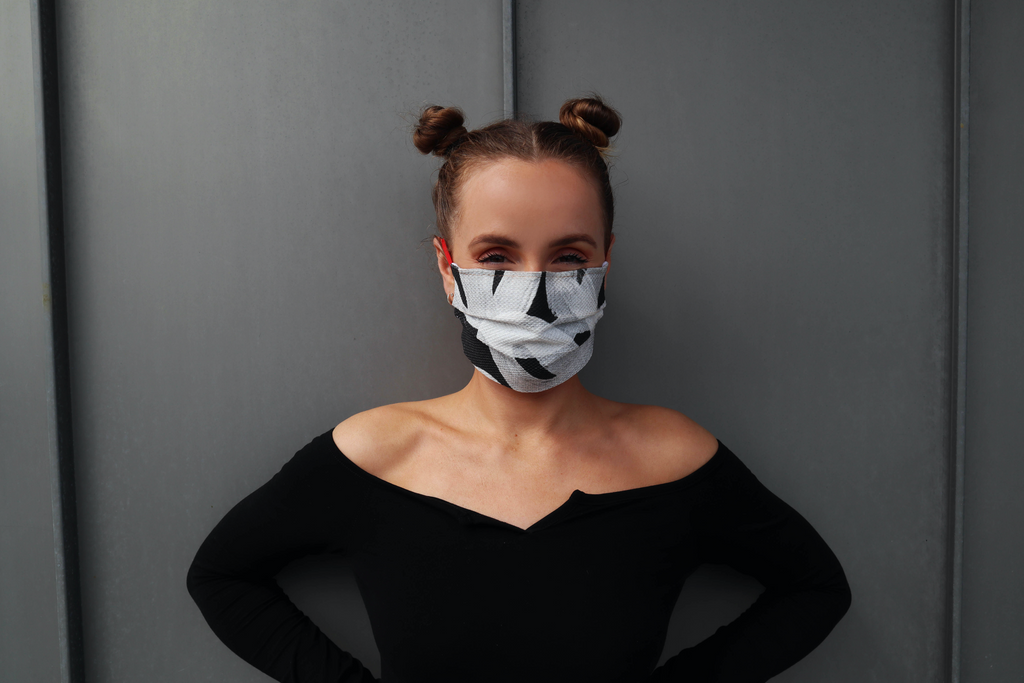 Niamh McCabe wearing a black and white ribbon tie face mask
