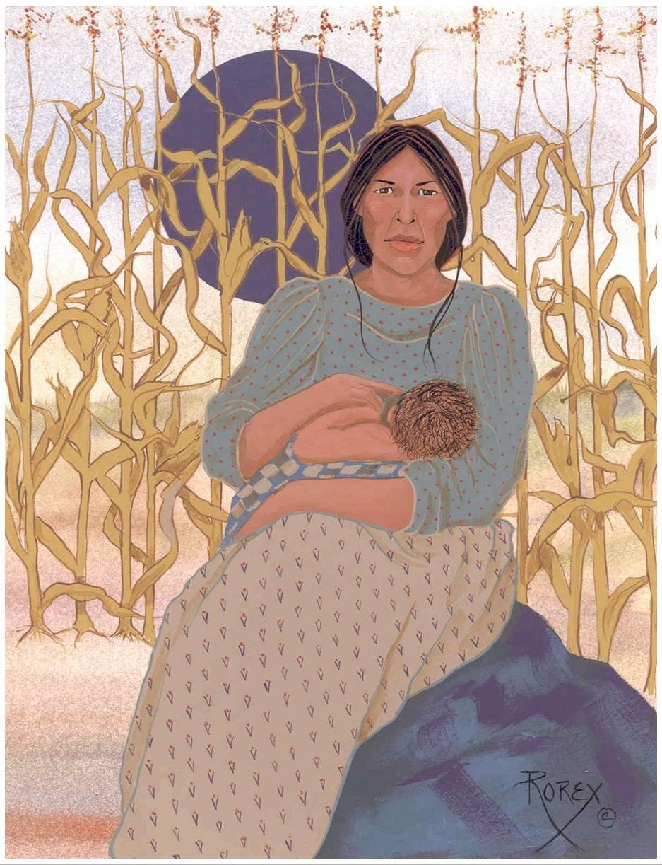 WOMAN NURSING BABY IN CORNFIELD