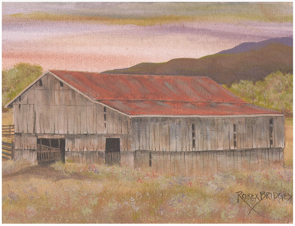 WEATHERED WOOD BARN WITH RED ROOF IN A VALLEY
