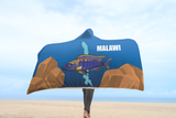 Aulonocara Lwanda Cichlid Lake Malawi Hooded Blanket shown with a person walking on the beach