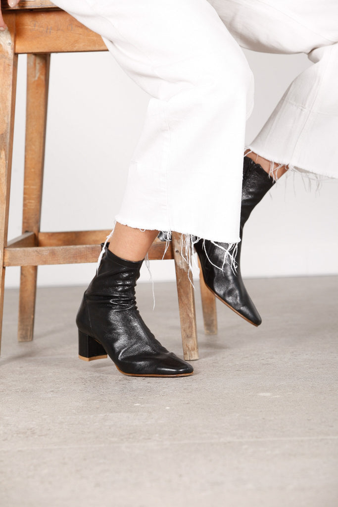 BY FAR SOFIA BLACK LEATHER ANKLE BOOTS