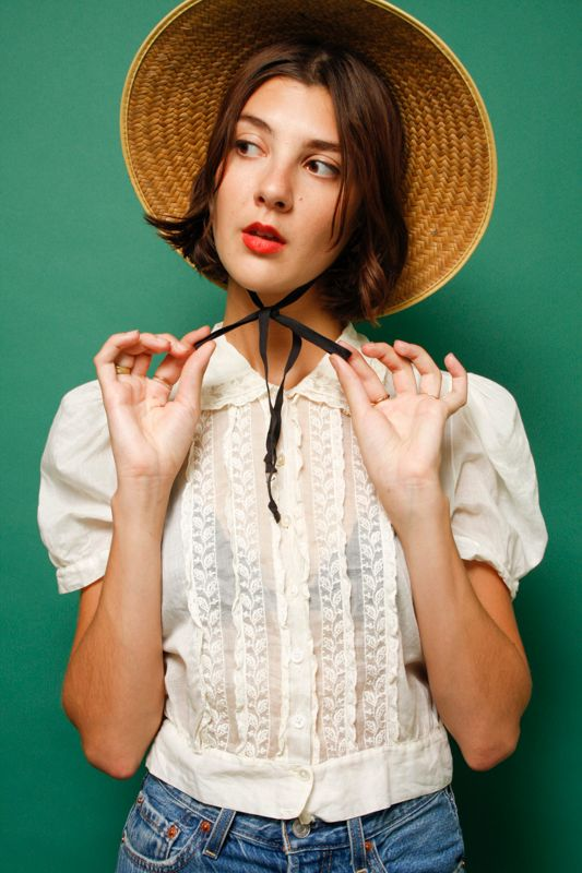 VINTAGE STRAW HAT WITH BLACK RIBBON