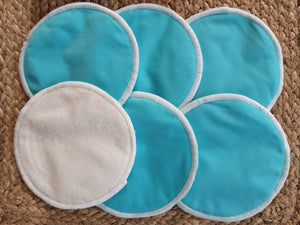 3 pairs of blue breastfeeding pads. One pad showing the bamboo fibre bottom layer