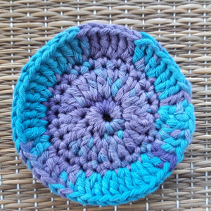 Blue and purple crocheted face scrubby
