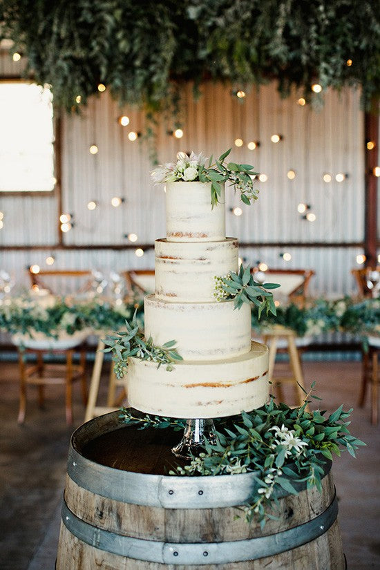 Semi-Naked-Wedding-Cake-With-greenery-550x825