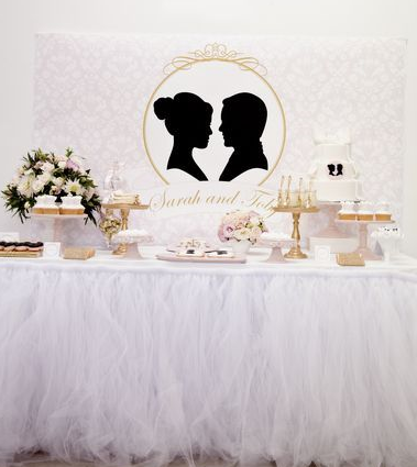 pink and gold silhouette theme wedding dessert table