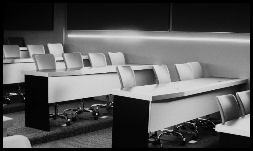 a black-and-white image of seating in an empty classroom