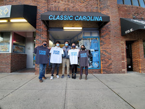 Launch Local Consultants and Kris Chellani in front of Classic Carolina showing off our UNC gear and funny t-shirts.