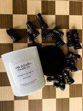 Load image into Gallery viewer, All natural soy wax candle Black Sand on a chess board. Front of candle