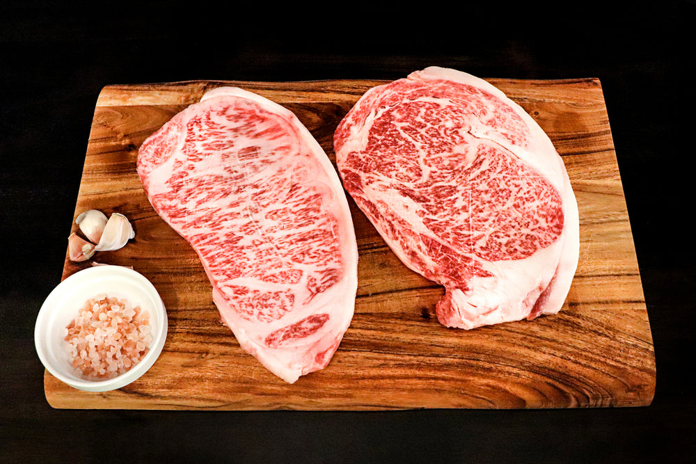 Japanese Authentic Wagyu Beef A5 grade, Highest grade Wagyu Ribeye & Striploin A5 Steak.  Beef is sourced from the Japanese Black Cattle (Kuroge).