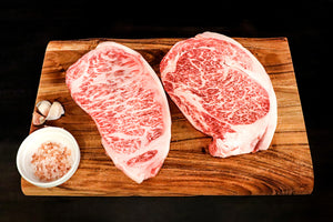 Load image into Gallery viewer, Japanese Authentic Wagyu Beef A5 grade, Highest grade Wagyu Ribeye & Striploin A5 Steak.  Beef is sourced from the Japanese Black Cattle (Kuroge).