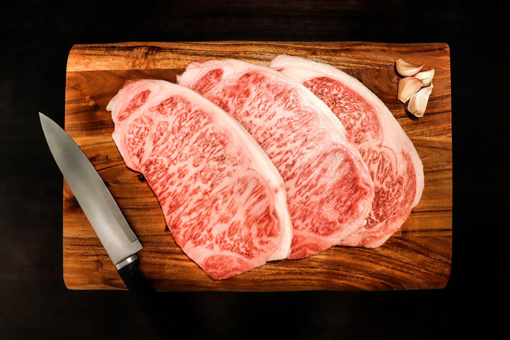 Japanese Authentic Wagyu Beef A5 grade, Highest grade Wagyu Striploin A5 Steak.  Beef is sourced from the Japanese Black Cattle (Kuroge).