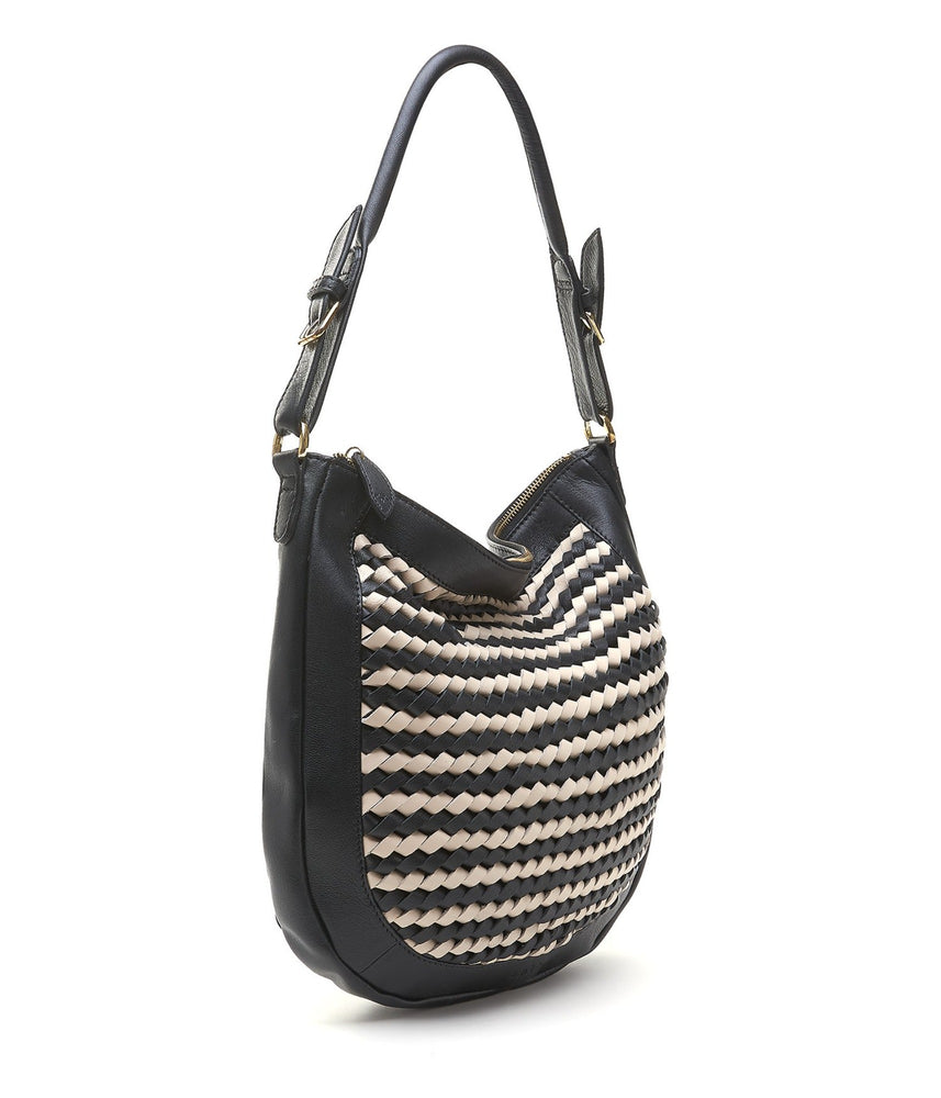 hand woven leather hobo cross body in black and powder cream
