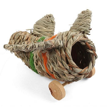 A toy aeroplane made out of woven straw with wooden wheels.