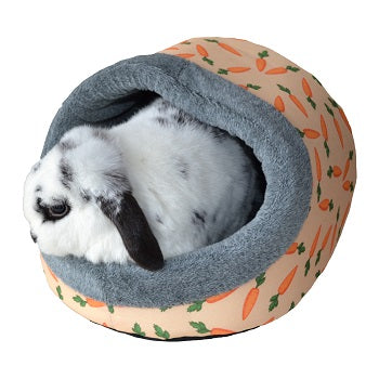 White and black rabbit in a hooded bed with carrot design and grey trim.