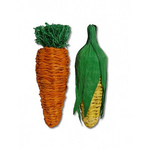 Two toys, one shaped like a carrot and the other like an ear of corn. Made from corn leaf and rattan.