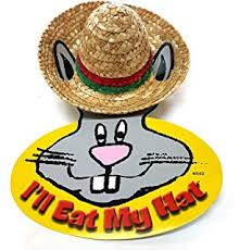 Straw sombrero attached to ears of cardboard depiction of a rabbit with the text 'I'll eat my hat'.