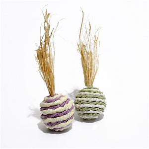 Two striped balls in alternating white and pastel colours with a plume of dried corn leaves out the top. Made of corn leaf and twisted paper.