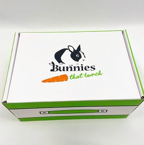 Picture of branded cardboard box with an illustration of a rabbit and the text 'Bunnies That Lunch'.