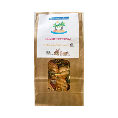 Brown bag with a plastic window containing dried leaves, fruit and vegetables. Label says 'Summer Festival'.