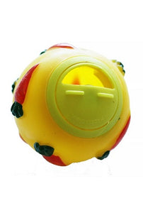 A spherical plastic yellow toy with embossed carrot designs on the exterior. It has a rotating access hole for inserting treats.