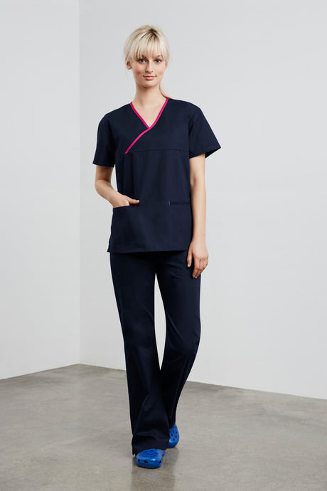 Woman wearing navy fuchsia contrast ladies crossover scrubs top