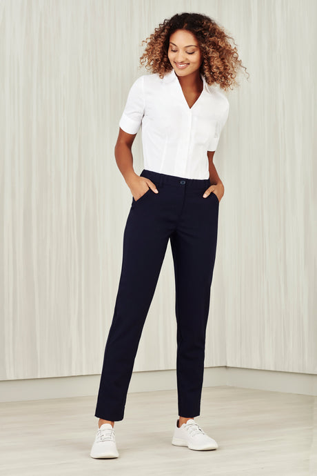 Woman wearing navy comfort waist slim leg pants