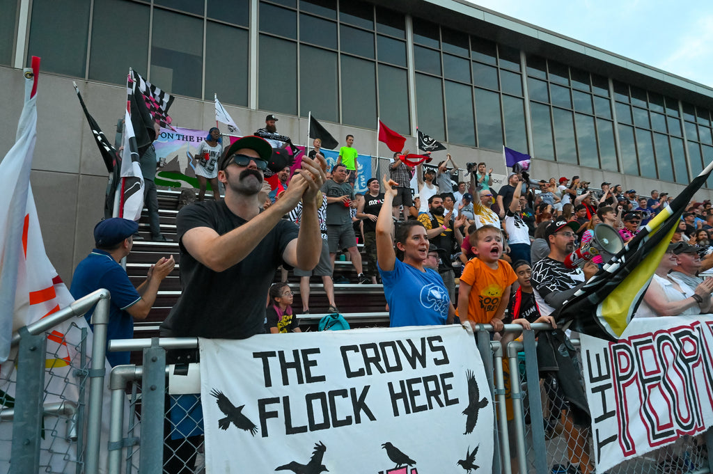 Minneapolis City fans cheer on the Crows at Edor Nelson Field