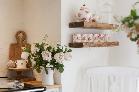 peony roses in white jug